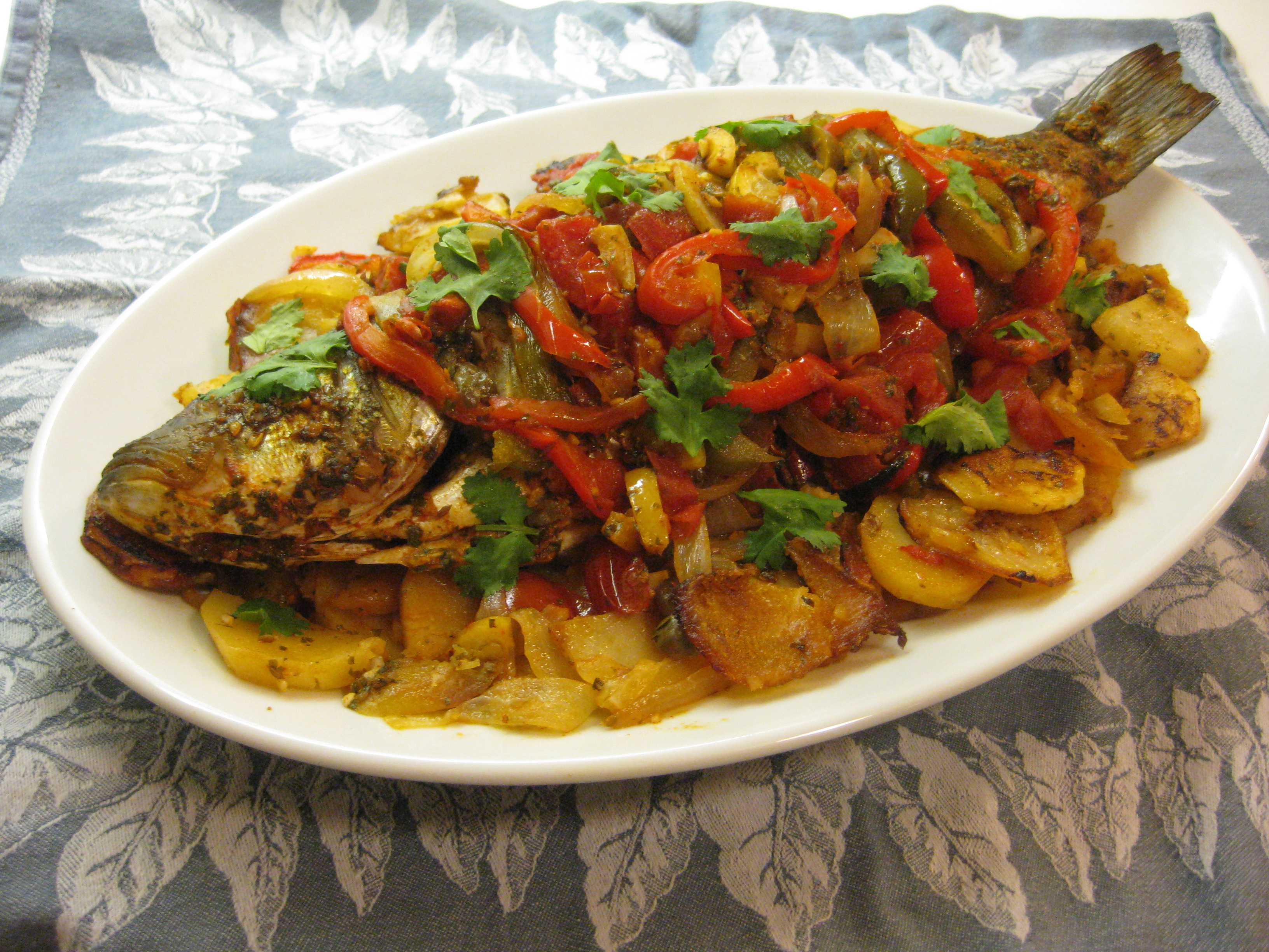 Moroccan feast baked fish with chermoula peppers and for African cuisine dishes